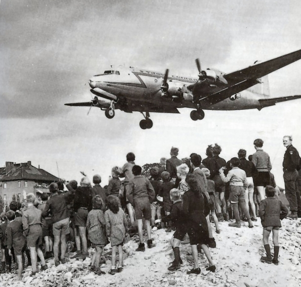 Berliners watching a C-54 land landing at Berlin Tempelhof Airport, 1948.