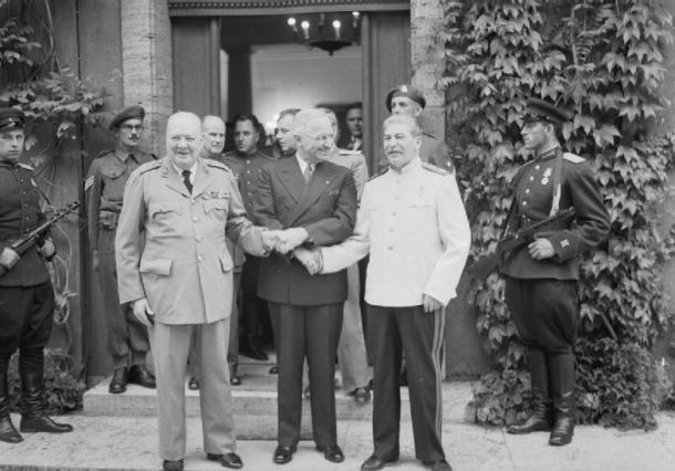Prime Minister Churchill, President Truman and Marshal Stalin shake hands after the Potsdam conference.