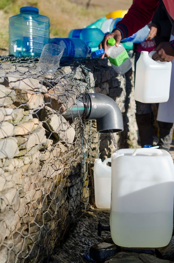 Grahamstown residents queue at the spring to fill containers with water just outside of Grahamstown, Photo: CuePix/Greg Roxburgh - NAF 2016
