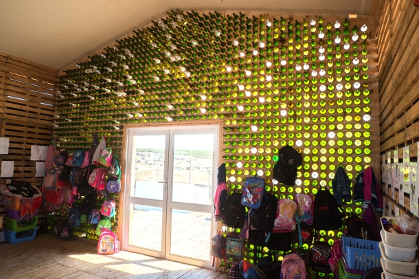 Glaswall made of old wine bottles