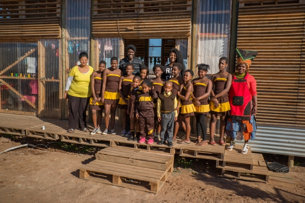 Kevin and Patricia and the children in front of the new creche